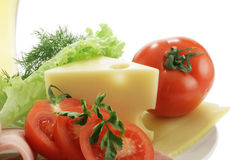 Cheese and tomatoes. Isolated over white background stock image