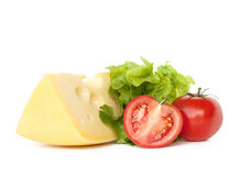 Cheese,tomatoes and green salad. On white stock image