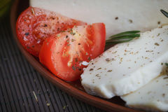 Cheese, tomatoes and herbs Royalty Free Stock Image