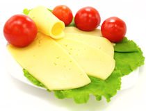 Cheese, tomatoes and lettuce on the plate. White plate with fresh  tomatoes, cheese  and lettuce Royalty Free Stock Photography
