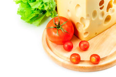 Cheese, tomatoes and lettuce. On white background Stock Photography