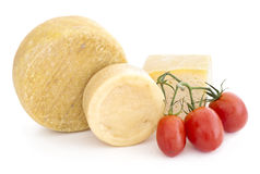Cheese and tomatoes over white background. Royalty Free Stock Image