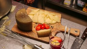 Cheese, tomatoes and sangria on a mat stock photos
