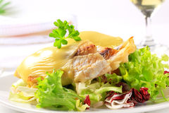 Cheese topped fish fillets with salad Stock Photography