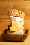 Cheese tower. Various kinds in wooden bowl. Vertical royalty free stock photography