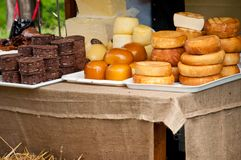 Cheese and traditional product display. Traditional Romanian cheese varieties displayed by a farmer at a medieval fair Royalty Free Stock Photography