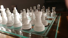 Cheese. Transparent glass chess Royalty Free Stock Images