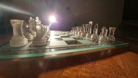 Cheese. Transparent glass chess Royalty Free Stock Image