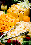 Cheese Tray. Assorted cheese tray with serving tong Stock Photo