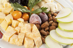 A cheese tray with fruit food party Stock Image