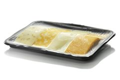 Cheese tray slices Stock Image