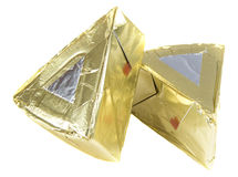 Cheese in triangle foil Stock Image