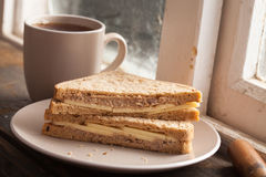 Cheese Tuna Sandwich. Cheese and Tuna Sandwich on a window will with a cup of coffee. Lunch at break Royalty Free Stock Images