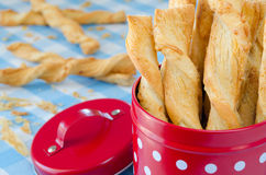Cheese twists in a box. Cheese twists pastry into a red box Royalty Free Stock Photos