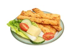 Cheese twists and salad Royalty Free Stock Photos