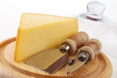 Cheese with utensils Stock Image