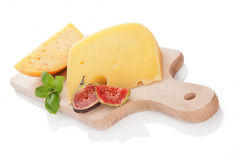 Cheese variaton on chopping board. Royalty Free Stock Image