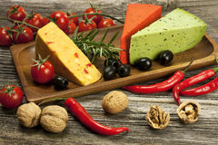 Cheese various assortment on wooden board Stock Image
