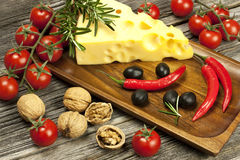 Cheese various assortment on wooden board Royalty Free Stock Image