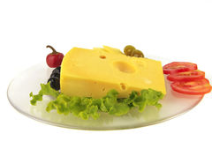 Cheese and vegetables on dish Royalty Free Stock Images