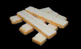 Cheese wafer on black background royalty free stock photos