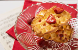 Cheese waffles with strawberries. In a vase of glass on a red napkin Royalty Free Stock Images