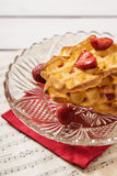 Cheese waffles with strawberries. In a vase of glass on a red napkin Stock Photography