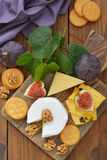 Cheese with walnuts and figs Stock Photography