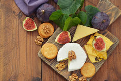 Cheese with walnuts and figs Stock Photos