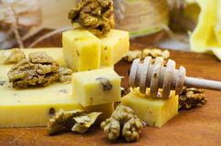 Cheese with walnuts and honey. Healthy wholesome food Royalty Free Stock Image