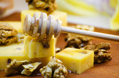 Cheese with walnuts and honey. Healthy wholesome food Stock Photography