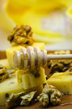 Cheese with walnuts and honey. Healthy wholesome food Royalty Free Stock Images
