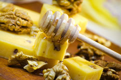 Cheese with walnuts and honey. Healthy wholesome food Stock Image