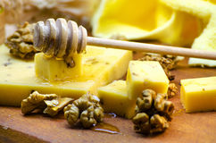 Cheese with walnuts and honey. Healthy wholesome food Royalty Free Stock Photography