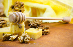 Cheese with walnuts and honey. Healthy wholesome food Royalty Free Stock Photos