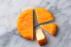 Cheese with washed orange rind. French or German. Marble table background. Top view. Cheese with washed orange rind. French or German. Marble table background royalty free stock image
