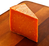 Cheese wedge Stock Images