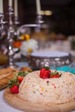 Cheese wheel at catered wedding reception. Catered wedding reception with strawberries, chocolate, punch, fruit, nuts, cheese 3 Royalty Free Stock Images
