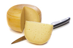 Cheese wheel with clice Stock Images