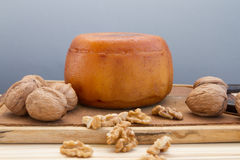 Cheese wheel with nuts Royalty Free Stock Images