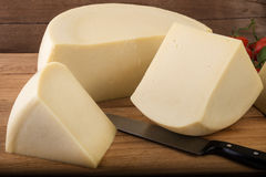 Cheese wheel and pieces Royalty Free Stock Photography