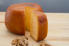 Cheese wheel and slice with nuts Stock Image