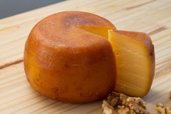 Cheese wheel and slice with nuts Royalty Free Stock Photography