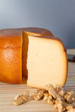 Cheese wheel and slice with nuts Stock Images