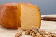 Cheese wheel and slice with nuts Royalty Free Stock Image