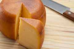 Cheese wheel and slice Stock Images
