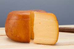 Cheese wheel and slice Stock Photography