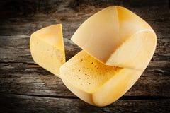 Cheese wheel on wood. Royalty Free Stock Photos