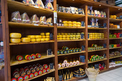 Cheese wheels. AMSTERDAM - AUGUST 26: Cheese wheels are on the shelves in the store on August 26, 2014 in Amsterdam Royalty Free Stock Photography