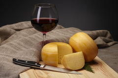 Cheese wheels with wine Royalty Free Stock Images